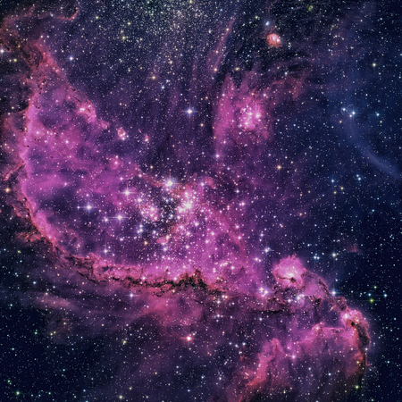 appears: NGC 346 is an open cluster with associated nebula located in the Small Magellanic Cloud that appears in the constellation Tucana. Retouched colored image. Elements of this image furnished by NASA. Stock Photo