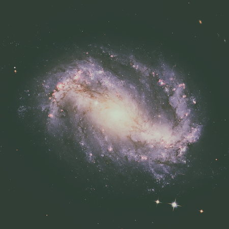 ursa minor: NGC 6217 is a barred spiral galaxy located some 67 million light years away, in the constellation Ursa Minor. Retouched image. Elements of this image furnished by NASA. Stock Photo