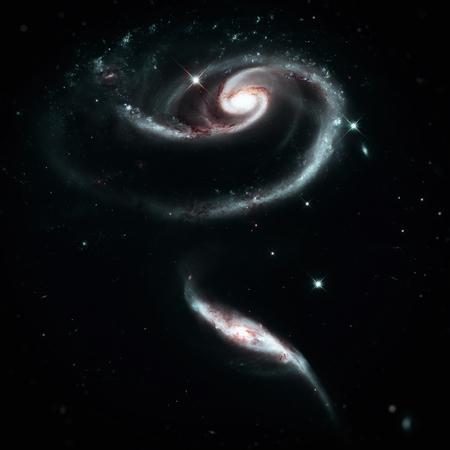 Uma rosa feita de galáxias UGC 1810 e UGC 1813. Grupo de galáxias espirais na constelação de Andrômeda. Elementos desta imagem fornecida pela NASA.