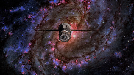 Spacecraft Progress orbiting the spiral galaxy