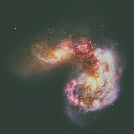 corvus: The Antennae Galaxies or NGC 4038 or NGC 4039 are undergoing a galactic collision. Located in the constellation Corvus. Stock Photo