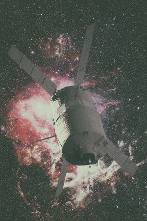 Cargo spacecraft - The Automated Transfer Vehicle over spiral galaxy.