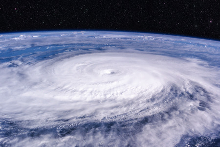 Typhoon over planet Earth - satellite photo. Elements of this image furnished by NASA. Zdjęcie Seryjne - 84045795