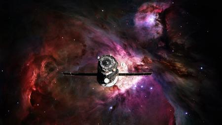 Spacecraft Progress orbiting the space nebula.