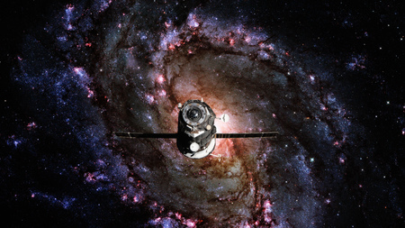 Spacecraft Progress orbiting the spiral galaxy. Elements of this image furnished by NASA.