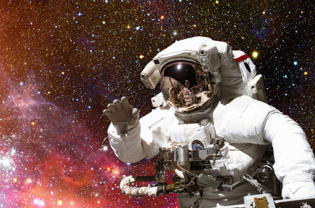 Astronaut in outer space against the backdrop of the outer space.