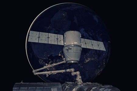 SpaceX Dragon orbiting the planet Earth. Stock Photo