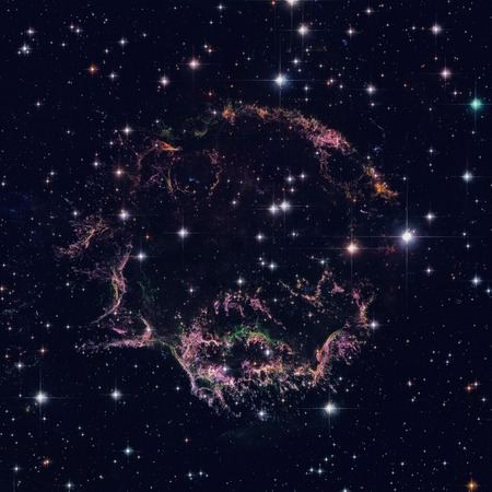 The tattered remains of a supernova explosion known as Cassiopeia A. Stock Photo