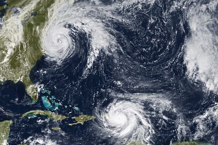 Hurricane Maria and Jose. Elements of this image furnished by NASA Фото со стока