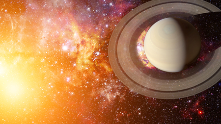 Saturn and his ring system. Elements of this image furnished by NASA. Stock Photo