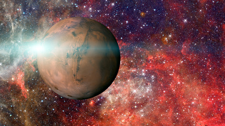 Planet Mars in the solar system. Elements of this image are furnished by NASA