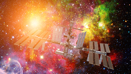 International Space Station over the planet Earth. Elements of this image furnished by NASA Stock Photo