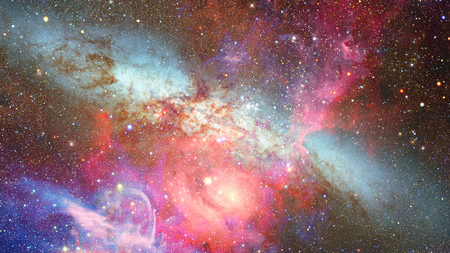 Colored nebula and open cluster of stars in the universe. Stock Photo