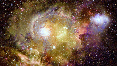 Nebula and stars in deep space. Bursting galaxy.