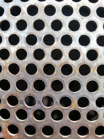 Hole Steel Metal in Black Background 版權商用圖片