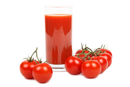 Tasty tomato juice and bunch of tomatoes isolated on white background. photo
