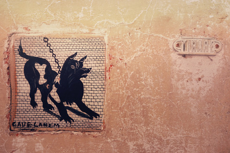 old sign: Cave Canem mosaic sign on old house wall in rome