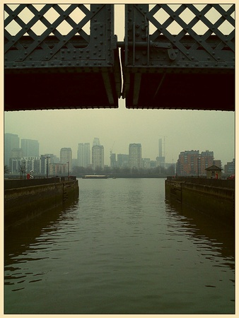 south london: Crossing the river quayside with view of the buildings opposite at South Sea Street, London, SE16