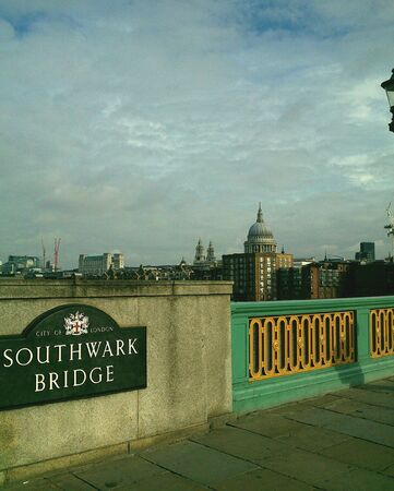 st pauls: St Pauls Cathedral seen from Southwark Bridge London with sign in foreground