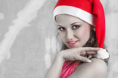 hait: sexy girl with red hait wearing santa claus clothes Stock Photo