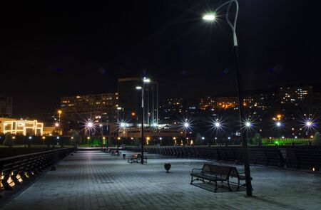 Night view of Baku with the Flame Towers skyscrapers, television tower and the seaside of the Caspian sea. Stock Photo