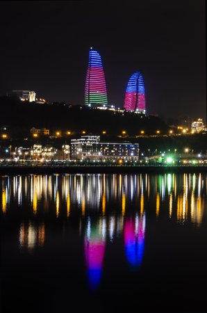 Night view of Baku with the Flame Towers skyscrapers, television tower and the seaside of the Caspian sea. Editorial
