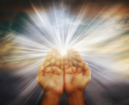 Prayer raised hands on cloudy background photo