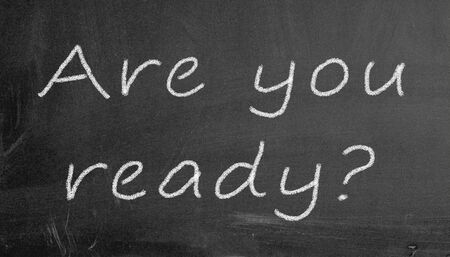 prompt: Illustration of are you ready written on black chalkboard Stock Photo