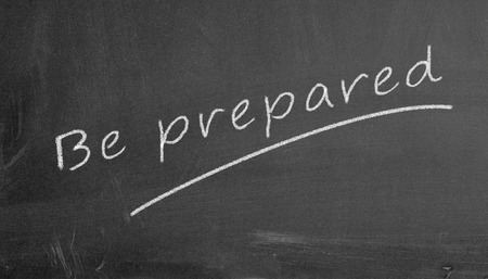 disaster preparedness: Illustration of be prepared written on black chalkboard Stock Photo