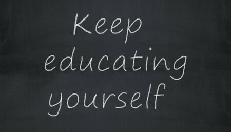 Illustration of keep educating yourself  written on black chalkboard illustration