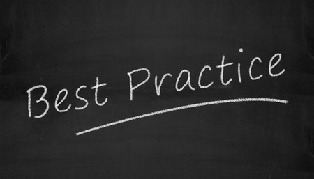 Illustration of best practice written on black chalkboard illustration