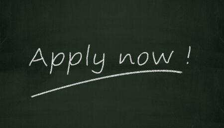 order now: Illustration of apply now written on black chalkboard