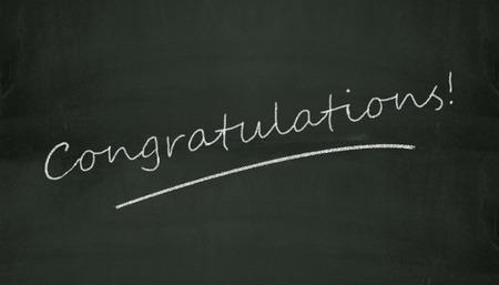 Illustration of congratulation written on black chalkboard Stockfoto