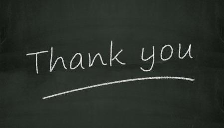 thankfulness: Illustration of thank you written on black chalkboard Stock Photo