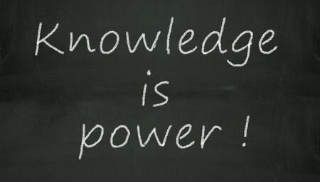 Illustration of knowledge is power written on black chalkboard illustration