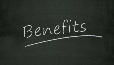 beneficial: Illustration of benefits written on black chalkboard