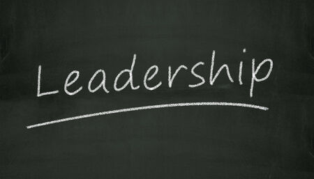 Illustration of leadership written on black chalkboard illustration
