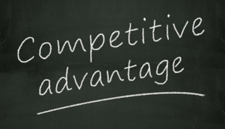Illustration of concept of competitive advantage written on black chalkboard illustration