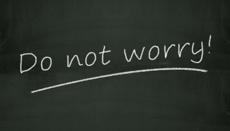 dont worry: Illustration of concept of dont worry written on black chalkboard