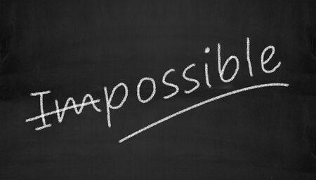 Illustration of possible impossible written on black chalkboard illustration