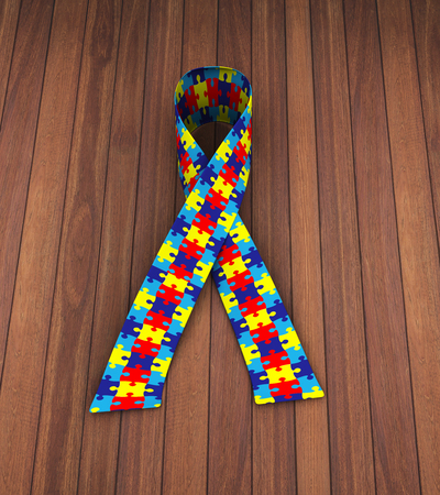 3d rendering of puzzle pattern ribbon symbolizing autism awareness
