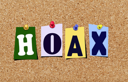 The word hoax in cut out magazine letters pinned to a cork noticeboard.
