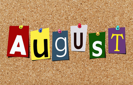 Illustration of word august in cut out magazine letters pinned to a cork noticeboard Stock Photo