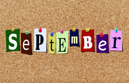Illustration of word september in cut out magazine letters pinned to a cork noticeboard Stok Fotoğraf