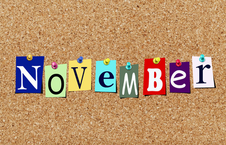 Illustration of word november in cut out magazine letters pinned to a cork noticeboard Stok Fotoğraf