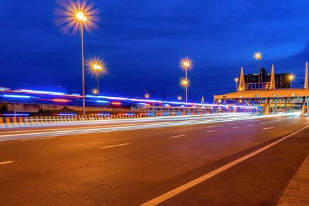 Cashier motorway junction  expressway bridge and traffic at night 写真素材
