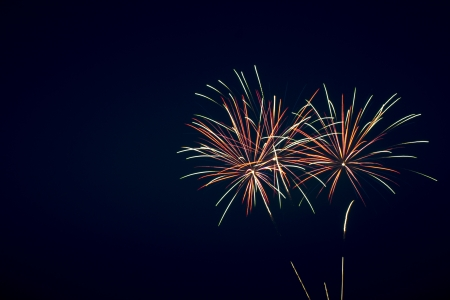 christmas in the city: Fireworks on the dark sky during the night of the feast. Stock Photo