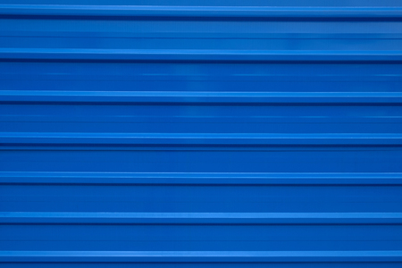 Blue color textured striped textured metal wall Stock Photo