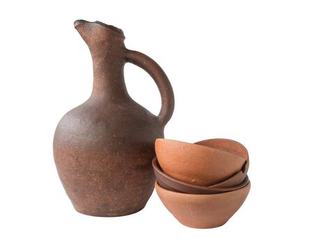 Georgian wine old clay jug with clay cup on white background, isolated 写真素材