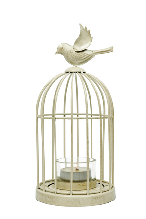 Vintage white metal cage with candle inside on a white background, isolated 写真素材